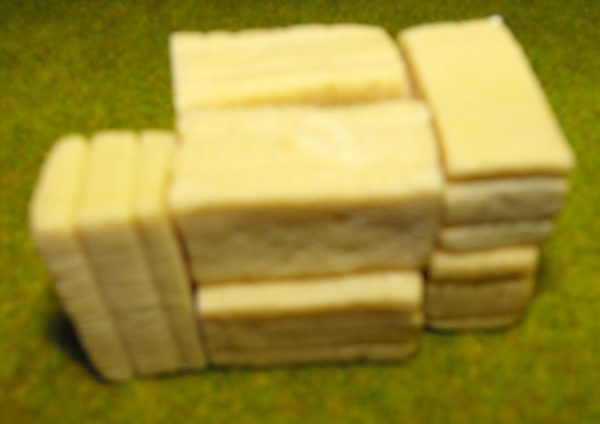 21-102 Shirecraft AC2 Hay Bales, rectangular Quantity 8 (unpainted). NB! The product picture shows this item painted and presented in a diorama.-853